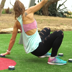 Female exercises with interactive BlazePods fitness lights