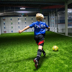 Young male football player uses ESA Precision Wall during training