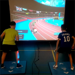 Kids play interactive athletic sports exergame game