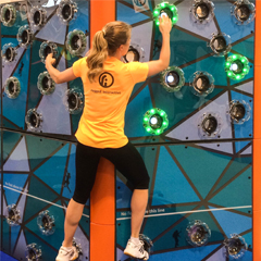 Girl climbs Rugged Interactive TrailBlazer Traverse climbing wall