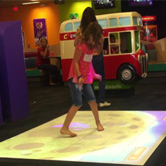 Female plays on interactive MagixFloor Arcade platform