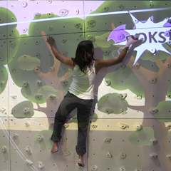 Augmented Climbing Wall with girl playing Whack-a-Bat exergame