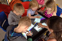 Group of children playing on After-Mouse.com interactive touch-table