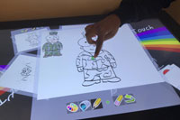 Young child uses touch-table colouring program