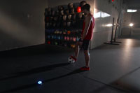Male uses fitness tech BlazePod wireless touch sensors for football soccer training