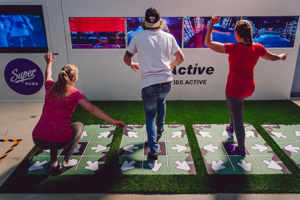 Players compete in positive gaming with 4-Active multiplayer system at exhibition