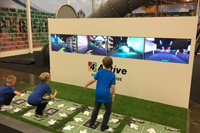 Kids play 4-Active multiplayer interactive game system
