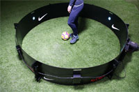 Male football player trains with ESA ICON Mini Fast Feet skills trainer
