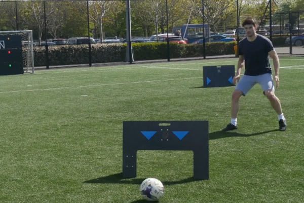 Young football player practices with Wireless Panels by Elite Skills Area