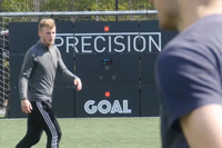 Male football players train with ESA Wireless Circuit and Precision Goal