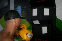 Young man boxing training with ESA Boxer Sports Technology