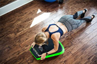 Mature female plank exercise at home with Stealth Core Trainer