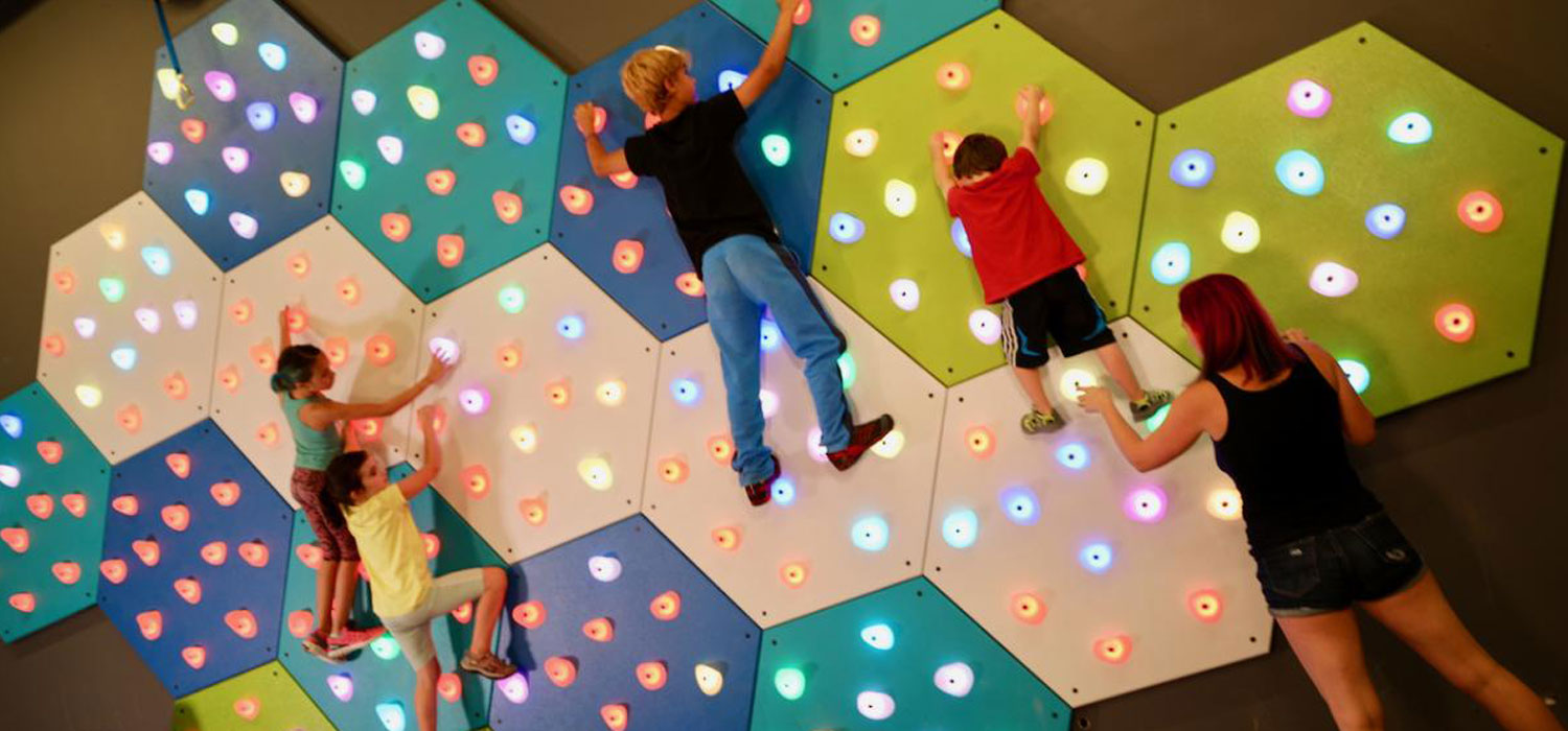 GlowHolds interactive climbing wall grips and hex panels